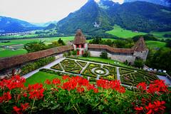 Chateau Garden in Gruyeres, Switzerland (` Toshio ') Tags: flowers mountains alps castle garden switzerland europe european swiss medieval gruyeres swissalps toshio xe2 chateaudegruyeres fujixe2
