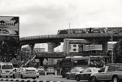 Victory Monument - Bangkok (jcbkk1956) Tags: street bus cars train thailand nikon traffic bangkok taxi vehicles nikkor skytrain victorymonument d3300
