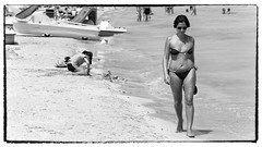 A sunny day at the beach - Canon EOS 7D - EF100-300mm f-5.6 (Beek2012) Tags: blackandwhite bw woman beach water canon blackwhite spain warm europa europe waterfront outdoor sunny bikini mallorca spanien alcudia ef100300mmf56 canoneos7d