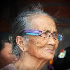 (scinta1) Tags: portrait people bali woman face indonesia temple glasses character traditional profile ceremony oldwoman kampung pura keluarga kintamani 2015 kedisan