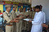 Eid celebration: MIRZAPUR- Police personnel being offered sweets after Eid-ul-Fitr namaz at Imambbara Mosque in Mirzapur on Thursday. (legend_news) Tags: mirzapur up india police personnel being offered sweets after eidulfitr namaz imambbara mosque thursday