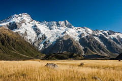 Field and Mountains 4 (The Burgys) Tags: newzealand mountains alps zeiss nationalpark sony mtcook southisland southernalps hdr mountcook aoraki carlzeiss a700 aorakimountcooknationalpark sal1680z sonya700 sal680z