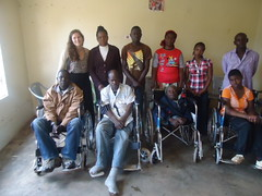 A team that received mobility aid donations