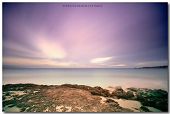 Elements (NikFly65) Tags: sardegna longexposure sunset sea italy cloud seascape color colour italia tramonto mare sardinia cloudy sigma wave bluehour spiaggia onde alghero scogli d90 orablu bombarde portoconte