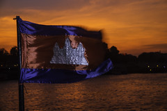 Cambodian Flag at sunset (Keith Kelly) Tags: city cruise sunset orange water river fun boat flying asia cambodia seasia southeastasia flag capital angkorwat fabric phnompenh kh breeze flapping aroundtown mekong tonlesap kampuchea