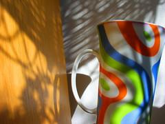 Morning coffee (mi ne volimo šalu) Tags: blue light shadow orange sun abstract colour green home cup coffee silhouette yellow furniture geometry illumination stillife asymmetry idyllic