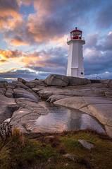 The Storm Surrenders (Darren Berg) Tags: sunset lighthouse water novascotia explore explored