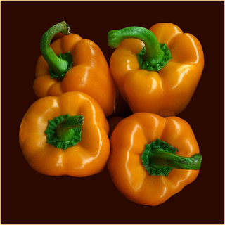 Four Orange Peppers