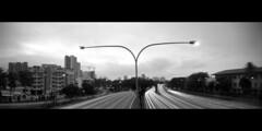 Darkness Falls (JamCanSing) Tags: longexposure sunset blackandwhite panorama film mediumformat highway singapore panoramic pinhole expressway bnw 6x17 reciprocity realitysosubtle