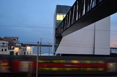 Have a nice trip! (TheManWhoPlantedTrees) Tags: bridge red portugal train lights footbridge library biblioteca tejo comboio vilafrancadexira arquitecturaportuguesa miguelarruda nikond3100 tmwpt