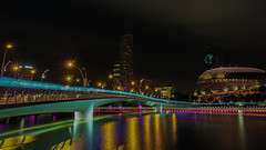 Illuminated (elenaleong) Tags: colors reflections nightscape landmark citylights lighttrails jubileebridge marinabay esplanadepark boattrails marinareservoir sg50  ilightmarina16