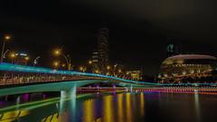 Illuminated (elenaleong) Tags: colors reflections nightscape landmark citylights lighttrails jubileebridge marinabay esplanadepark boattrails marinareservoir sg50 金禧桥 ilightmarina16