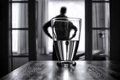 the wait (*Chris van Dolleweerd*) Tags: man reflection water table dof refraction wait vase chrisvandolleweerd