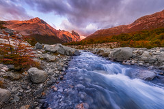 Rushing Through ( (Ping...) Tags: morning autumn trees sky patagonia mountains fall nature creek sunrise landscape colorful stream rapids range alp rivulet