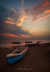 Sunset Over Fisherman Boats (abhishek.deopurkar) Tags: ocean pink blue sunset sea summer sky india seascape beach water clouds landscape boats evening coast boat colorful waves ray dusk pastel tide indianocean peaceful delight maharashtra rays flowing magical