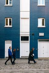 Blue (lorenzoviolone) Tags: blue windows england building london walking doors unitedkingdom strangers streetphotography cobblestone finepix fujifilm streetphoto fujiastia100f mirrorless vsco streetphotobw vscofilm fujix100s x100s fujifilmx100s travel:uk=londonapr16 pedstrains