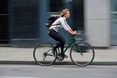 The sound of her own drum (jeremyhughes) Tags: bicycle cyclist cycling rider woman wheels green commuter street city transport style shirt earbuds reverie mixte movement motion speed panning nikon london d750 nikkor 80200mmf28d oldstreet chic cyclechic ipod