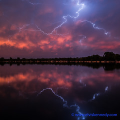 100 Days of Summer #12 - Reflected Lightning (elviskennedy) Tags: county blue sunset summer vacation sky orange sun lake storm reflection tree green water colors june wisconsin night clouds zeiss dark landscape fire mirror evening us high colorful long exposure waves power unitedstates dynamic outdoor sony scenic elvis calm 25 cumulus bolt electricity thunderstorm f2 lightning alpha range wi spruce kennedy hdr highdynamicrange a7 25mm thunderhead batis suring oconto kellylake a7r 100daysofsummer wwwelviskennedycom elviskennedy a7rii