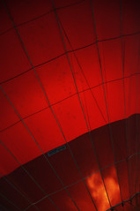 DSC_5675 [ps] - Chromosphere (Anyhoo) Tags: uk red england orange fire grid balloon surrey virgin burning flame burn fabric flare hotairballoon material cloth stitched incandescent dunsfold plume seams anyhoo photobyanyhoo