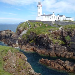 Lighthouse at Fanard (gowersaint) Tags: europe ireland donegal fanad coast coastline coastal lighthouse safety light lamp people steps cliff rocks tourist sea waves water white end edge rescue shipping guide