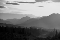 Dusty Valley  in B&W (Rebeak) Tags: road travel sky bw mountains tree clouds movement hills valley dust