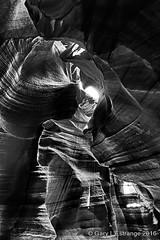 Antelope Canyon 10 (garylestrangephotography) Tags: light arizona blackandwhite usa white abstract black texture tourism monochrome rock stone dark landscape grey mono blackwhite nationalpark pattern outdoor indian surreal wave monotone tourist canyon serene slot touristattraction reservation antelopecanyon navajonation touristdestination touristlocation garylestrangephotography