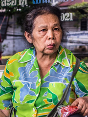 Sad eyes (Willfrolic) Tags: old blue portrait woman green eye look fruit thailand eyes colorful sad bangkok thinking stare wrinkles seller thonglor