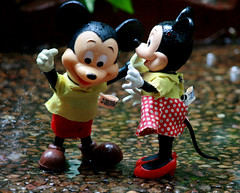 Mickey and Minnie out playing in the rain... (The Dolly Mama) Tags: rain vintage mouse toys backyard disney mickey minnie splash