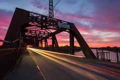 Sunset Ride (boingyman.) Tags: ca bridge light sunset urban color car landscape cityscape crossing lighttrails sacramento scape intensity americanriver istreetbridge boingyman