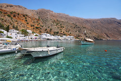 Loutro (Miguel Virkkunen Carvalho) Tags: travel houses light shadow sea summer mountains nature water composition digital canon boats photography seaside scenery europe mediterranean village angle outdoor turquoise south sigma august scene greece crete remote emerald whitewashed southerneurope loutro crystalclear sigma1020mm sfakia libyansea southcrete eos1000d