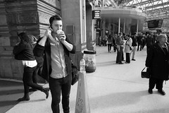 Guy with banana, Waterloo Station (fabiolug) Tags: street leica people blackandwhite bw man guy london water monochrome look station sign mobile blackwhite bottle phone looking drink cone candid wide streetphotography rangefinder wideangle banana bin waterloo mobilephone rubbish monochrom talking biancoenero waterloostation superwideangle 21mm candidphotography londonist slipperyfloor superwide leica21mm leicam superelmar leicasuperelmar21mmf34asph superelmar21mm leicasuperelmar mmonochrom leicammonochrom leicamonochrom superelmar21mmf34asph leicasuperelmar21mm