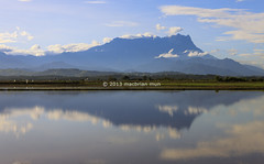 Reflection of Mount Kinabalu at Sabah, Borneo, Malaysia (Macbrian Mun) Tags: park morning travel blue vacation sky cloud sun sunlight mountain lake cold color reflection tree green nature water colors beautiful skyline landscape countryside high scenery asia warm peace view natural outdoor altitude hill scenic peak sunny landmark scene calm mount national malaysia summit land mountkinabalu exploration majestic chill sabah kinabalu