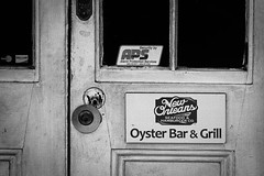ersters 'n beer (Mr. Greenjeans) Tags: door blackandwhite bw louisiana doors neworleans entrance frenchquarter signage toned vieuxcarre gaylonkeeling