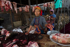 Apatani butcher. Ziro, Arunachal Pradesh. NE India (NeSlaB ф.) Tags: poverty she travel woman india colors look tattoo canon photo women asia dress indian traditional country culture photojournalism belief plate s tribal meat clothes butcher ornaments f tradition apa tribe ethnic society developingcountries reportage nationalgeographic ethnography ethnology neindia credence ziro ethnies apatani noseplugs neslab davidecomelli