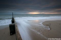 (Claire Hutton) Tags: uk longexposure light sunset sea england sun seascape colour beach water lens prime coast seaside sand waves britain wideangle stormy le rush dorset rays groyne bournemouth southbourne leefilters 09hardgrad sonynex5r samyang12mmf20