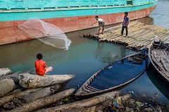 A little boy is enjoying the fishing!! (ashik mahmud 1847) Tags: boy people man color water kids river boat fishing nikkor bangladesh d5100