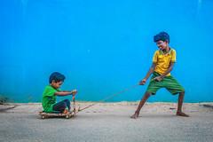 ( - Skateboard) (VENGAT SIVA) Tags: india rural village traditional streetphotography games skateboard roadside tamil tamilnadu roi indianstreetphotography aattam rootsofindia aadukalam wikipidea