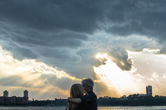 The creation of love. (tmarcuz) Tags: street light sunset sky sun newyork love water couple