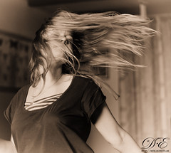 Dancing (debahi) Tags: people woman girl monochrome sepia hair dance nikon dancing air blond