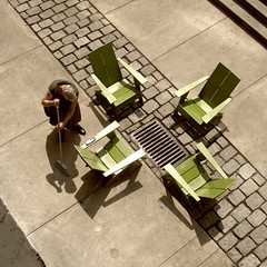 quintet (weltreisender2000) Tags: atlanta shadow urban woman green four chairs geometry diagonal patio broom