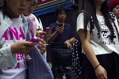 marvel (edwardpalmquist) Tags: street city travel people urban man girl fashion japan shopping tokyo phone crowd shibuya harajuku takeshitastreet