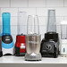 Group of personal blenders on counter