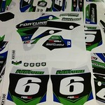 """FAMmx Design custom motocross graphics for Buddy Fortune's Kawasaki KX100s and Levi Fortune's Kawasaki KX65. To see more graphic kits, visit our website at www.fammx.com <a style=""""margin-left:10px; font-size:0.8em;"""" href=""""http://www.flickr.com/photos/99185451@N05/27521489153/"""" target=""""_blank"""">@flickr</a>"""