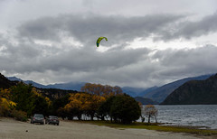 It is Getting away fromHim (Jocey K) Tags: autumn trees newzealand sky people mountains cars clouds wind autumncolours southisland centralotago windsurfing windsurfer lakewanaka tripdownsouth