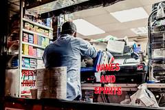 Wine And Spirits (Sean Batten) Tags: street city england urban london shop night 35mm nikon unitedkingdom soho streetphotography nighttime gb d800 shopkeeper photo24london