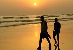 Walking Past the Sunset (Protikz Flikz) Tags: sea seabeach coxs bazar bayofbengal indianocean sunset coastal bangladesh