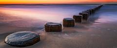 far far away (FH   Photography) Tags: longexposure sunset sea beach strand landscape sand wasser outdoor sandy natur nopeople balticsea coastline meditation ufer holz landschaft weite ostsee horizont esoterik kste groynes freiheit naturre ruhe buhnen