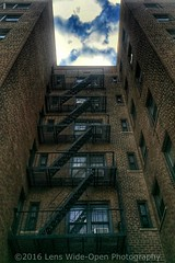 Escape (jomak14) Tags: newyork july4thweekend2016 wheremyrunningshoestakeme iphone6plus architecturaldetails sky clouds fireescape windows