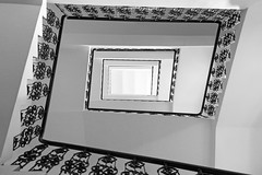 Staircase in Prague 2 (Romeodesign) Tags: bw white house black art up stairs spiral prague geometry interior perspective staircase handrail railing levels treppen abtract 550d