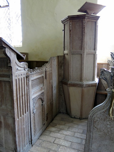 Only svelte clergy need apply: The very narrow octagonal Stuart pulpit and early 17th C. reading desk on the left, the Church of St Mary, Badley, Suffolk, England